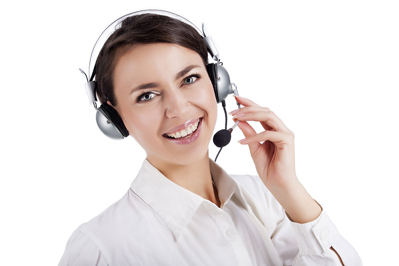 Young lady speaking on a headset device