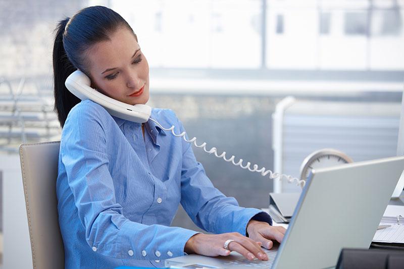 Lady speaking on landline phone