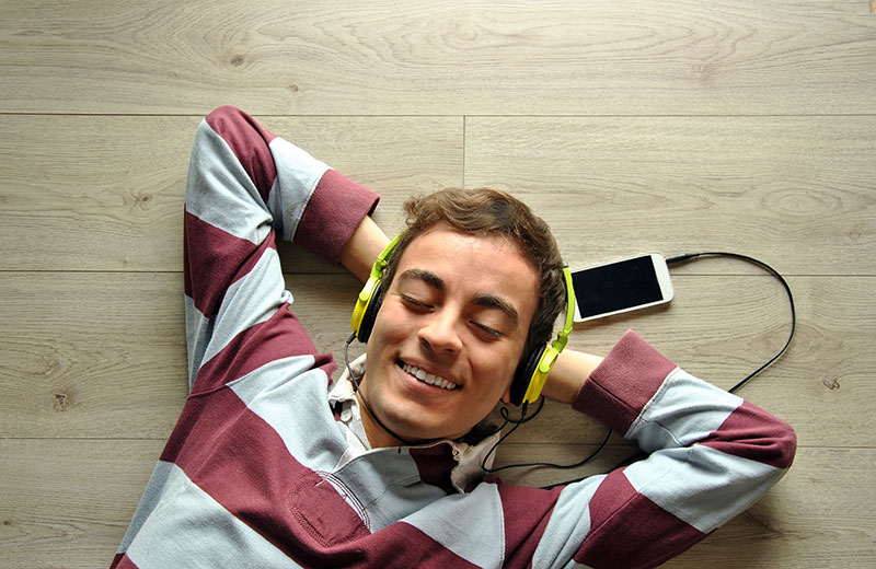 Man listening to music from his mobile phone